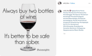"""Wine glass with red wine and the text """"Always buy two bottles of wine. It's better to be safe than sober""""."""